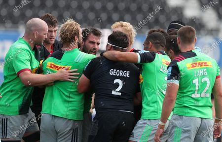 Players pull apart Jamie George of Saracens and Scott Baldwin of Harlequins