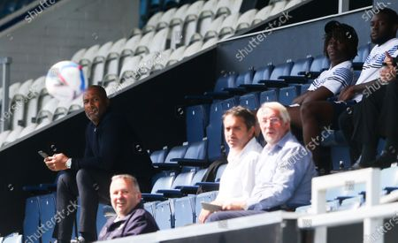 Les Ferdinand - QPR Director of Football  (L) keeps his eye on the ball - Eberechi Eze of QPR to his right in cap