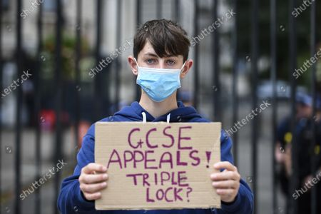 GCSE and BTec student Tommy Walsh (aged 16) joins students protesting outside Downing Street calling for the resignation of Gavin Williamson, Secretary for Education, following this year's exam results chaos. After a successful campaign for A-Level and GCSE students to have grades based on teacher assessments rather than on a computer algorithm, BTec students will have to wait while exam board Pearson regrades their results. (Parental permission obtained)