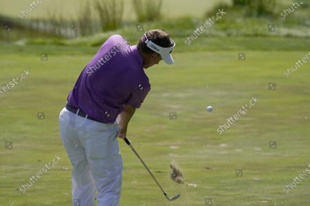Ian Poulter hits off the fairway on his approach to the 17th green during the second round of the Northern Trust golf tournament at TPC Boston, in Norton, Mass
