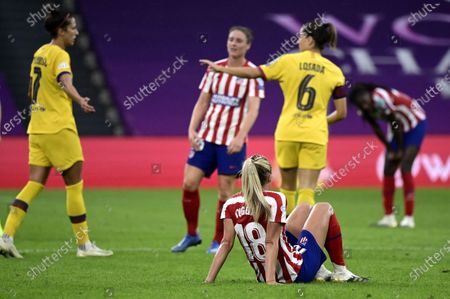 A dejected Toni Duggan of Atletico sits on the pitch after the UEFA Women Champions League quarter final match between Atletico Madrid and Barcelona in Bilbao, Spain, 21 August 2020. Barcelona won 1-0.