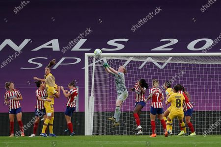 Atletico Madrid's goalkeeper Hedvig Lindahl jumps to save the ball during the Women's Champions League quarterfinal soccer match between Atletico Madrid and Barcelona at the San Mames stadium in Bilbao, Spain
