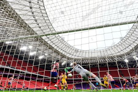 Atletico Madrid's goalkeeper Hedvig Lindahl dives to save a shot during the Women's quarter-final Champions League soccer match between Atletico Madrid and Barcelona at the San Mames stadium in Bilbao, Spain