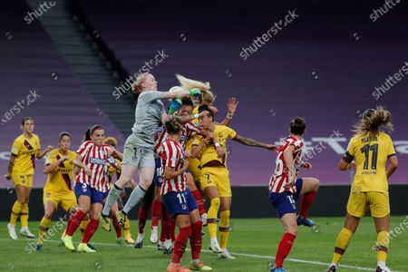 Atletico Madrid's goalkeeper Hedvig Lindahl jumps to punch the ball away during the Women's Champions League quarterfinal soccer match between Atletico Madrid and Barcelona at the San Mames stadium in Bilbao, Spain