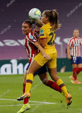Atletico Madrid's Alia Guagni, left and Barcelona's Lieke Martens challenge for the ball during the Women's Champions League quarterfinal soccer match between Atletico Madrid and Barcelona at the San Mames stadium in Bilbao, Spain