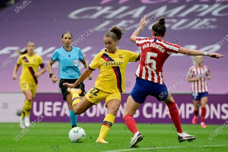 Barcelona's Lieke Martens prepares to shoot during the Women's quarter-final Champions League soccer match between Atletico Madrid and Barcelona at the San Mames stadium in Bilbao, Spain