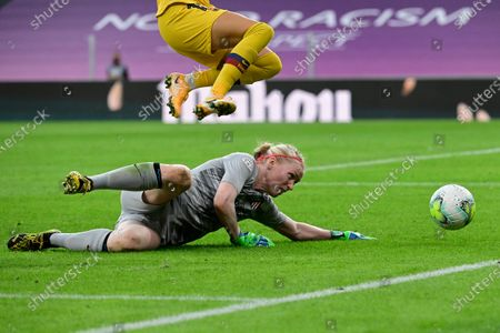 Atletico Madrid's goalkeeper Hedvig Lindahl reaches to save the ball during the Women's quarter-final Champions League soccer match between Atletico Madrid and Barcelona at the San Mames stadium in Bilbao, Spain