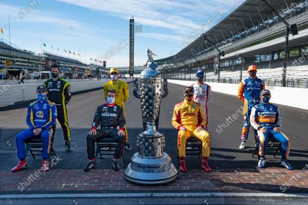 Past winners of the Indianapolis 500 pose with the Borg-Warner Trophy on the start/finish line at Indianapolis Motor Speedway in Indianapolis, . They are left to right, front row, Alexander Rossi, Will Power, of Australia, Ryan Hunter-Reay, and Takuma Sato, of Japan. Back row, left to right, Simon Pagenaud, of France, Helio Castroneves, of Brazil, Tony Kanaan, of Brazil, and Scott Dixon, of New Zealand. The 104th running of the Indianapolis 500 auto race is scheduled to run on Sunday
