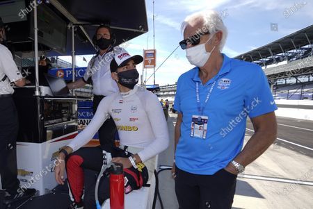 Stock Image of Rinus VeeKay, of the Netherlands, left foreground, talks with Arie Luyendyk before the final practice session for the Indianapolis 500 auto race at Indianapolis Motor Speedway, in Indianapolis