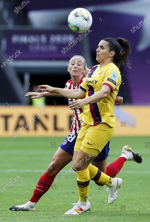 Toni Duggan (L) of Atletico in action against Andrea Pereira of Barcelona during the UEFA Women Champions League quarter final match between Atletico Madrid and Barcelona in Bilbao, Spain, 21 August 2020.