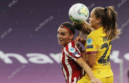 Alia Guagni (L) of Atletico in action against Lieke Martens (R) of Barcelona during the UEFA Women Champions League quarter final match between Atletico Madrid and Barcelona in Bilbao, Spain, 21 August 2020.