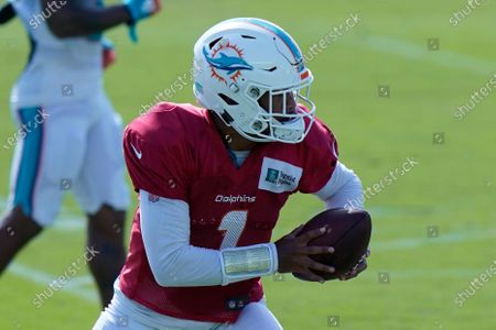 Miami Dolphins quarterback Tua Tagovailoa (1) runs drills during practice at the NFL football team's training facility, in Davie, Fla. Miami Dolphins quarterback Ryan Fitzpatrick is missing practice for personal reasons. Fitzpatrick's absence left top draft pick Tagovailoa and quarterback Josh Rosen to take snaps Friday