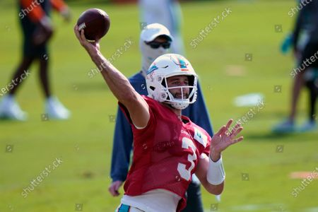 Miami Dolphins quarterback Josh Rosen (3) throws during practice at the NFL football team's training facility, in Davie, Fla. Miami Dolphins quarterback Ryan Fitzpatrick is missing practice for personal reasons. Fitzpatrick's absence left Rosen and top draft pick Tua Tagovailoa to take snaps Friday