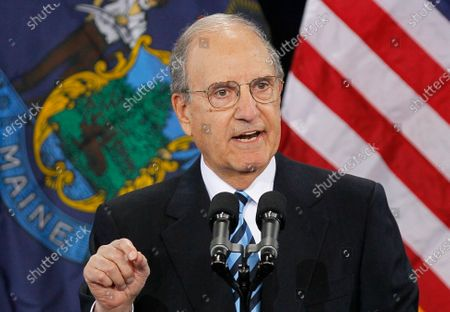 Former Senate Majority Leader George Mitchell speaks in South Portland, Maine. The former senator and peace envoy to Northern Ireland, is beginning treatment for leukemia at a Boston hospital, a day after his 87th birthday
