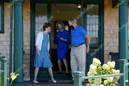 Former President George W. Bush holds the door for Sen. Susan Collins, R-Maine, and his wife Laura Bush after having lunch at their home, in Kennebunkport, Maine. George W. Bush on Friday backed Collins in his first public endorsement of the 2020 election cycle