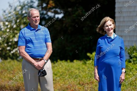 Former President George W. Bush and his wife Laura Bush look on after speaking about Sen. Susan Collins, R-Maine, in Kennebunkport, Maine