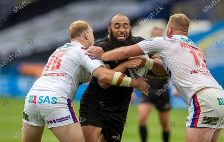 Sam Kasiano of Catalan Dragons is tackled by Craig Kopczak and Joe Westerman of Wakefield Trinity; The John Smiths Stadium, Huddersfield, Yorkshire, England; Rugby League Coral Challenge Cup, Catalan Dragons versus Wakefield Trinity.