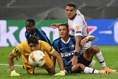Goalkeeper Yassine Bounou (L) and Diego Carlos (R) of Sevilla and Victor Moses (rear L) and Alexis Sanchez of Inter watch the ball rolling towards goalline during the UEFA Europa League final match between Sevilla FC and Inter Milan in Cologne, Germany 21 August 2020.