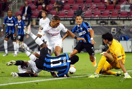 Stock Photo of Victor Moses (C) of Inter in action against Sevilla's goalkeeper Yassine Bounou (R) during the UEFA Europa League final match between Sevilla FC and Inter Milan in Cologne, Germany, 21 August 2020.