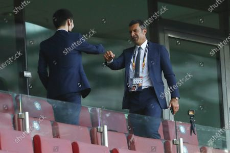 Stock Photo of Inter Milan President Steven Zhang, left, meets former soccer star Luis Figo prior to the start of the Europa League final soccer match between Sevilla and Inter Milan in Cologne, Germany