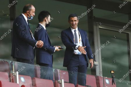 Inter Milan President Steven Zhang, center, talks with former soccer star Luis Figo, right, prior to the start of the Europa League final soccer match between Sevilla and Inter Milan in Cologne, Germany