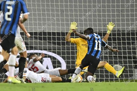 Inter Milan's Victor Moses, right, is stopped by Sevilla defenders during the Europa League final soccer match between Sevilla and Inter Milan at the Rhein Energie Stadium in Cologne, Germany
