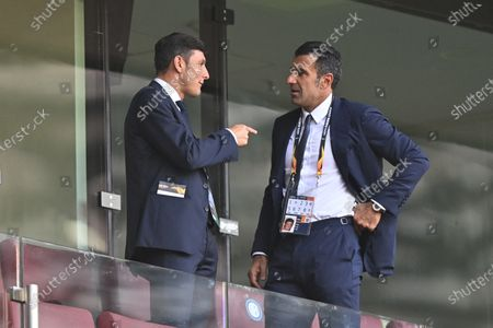 Former Inter Milan's players Javier Zanneti, left, and Luis Figo chat on the stands ahead of the during the Europa League final soccer match between Sevilla and Inter Milan at the Rhein Energie Stadium in Cologne, Germany