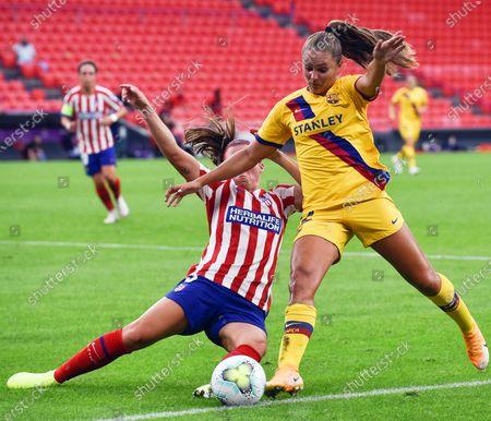 Barcelona's Lieke Martens (R) in action against Atletico Madrid's Alia Guagni (L) during the UEFA Women Champions League quarter final soccer match between Atletico Madrid and Barcelona in Bilbao, Spain, 21 August 2020. Barcelona won 1-0.