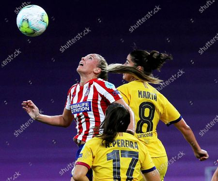 Atletico Madrid's Toni Duggan (L) in action against Barcelona players Andrea Pereira (C) and Marta (R) during the UEFA Women Champions League quarter final soccer match between Atletico Madrid and Barcelona in Bilbao, Spain, 21 August 2020. Barcelona won 1-0.