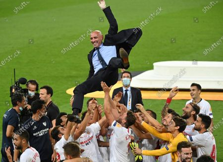 Sevilla players celebrate with Sevilla's general sports manager Ramon Rodriguez Verdejo after winning the Europa League final soccer match between Sevilla and Inter Milan in Cologne, Germany