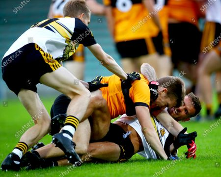Austin Stacks vs Dr. Crokes. Dr. Crokes' Gavin O'Shea and Michael Burns argue with Dylan Casey of Austin Stakes
