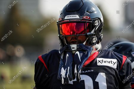 Houston Texans running back David Johnson gets ready for practice during an NFL training camp football practice, in Houston