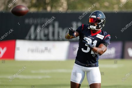 Houston Texans running back David Johnson (31) reaches out to make a catch during an NFL training camp football practice, in Houston