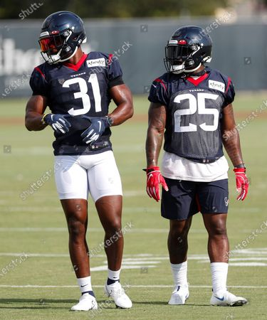 Houston Texans running backs David Johnson (31) and Duke Johnson (25) walk together across the field during an NFL training camp football practice, in Houston