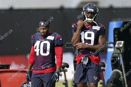 Houston Texans wide receiver Isaac Whitney (19) watches during an NFL training camp football practice, in Houston