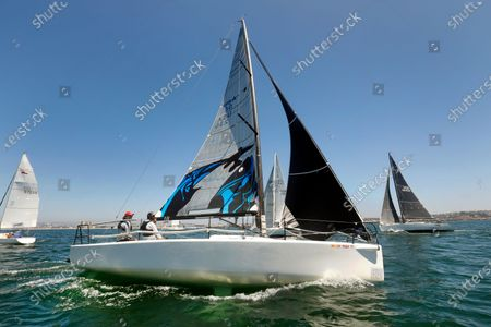 Stock Picture of Marina del Rey, California-Aug. 8, 2020-Following COVID-19 required guidelines, racers take part in a new series in Santa Monica Bay, run by Del Rey Yacht Club. Only racers living in the same household are allowed to sail together. Rich Festa, left, and Tony Festa, right, race as a two-person family team. (Carolyn Cole/Los Angeles Times)