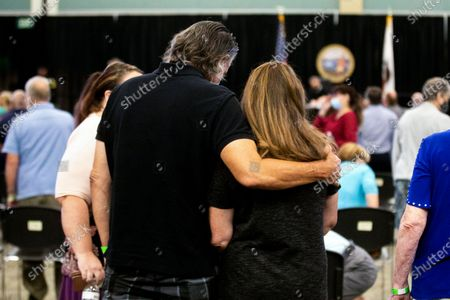 Stock Photo of Brian James embraces Sandy James (Sandy's sister is Deborah Strouse, who DeAngelo broke into her home and raped her in 1977) after the sentencing of Joseph James DeAngelo Jr. at CSU Sacramento, California, USA, 21 August 2020.DeAngelo Jr., 74, was sentenced to multiple life sentences in prison without the possibility of parole, under a plea agreement that allowed him to avoid the death sentence. In June, DeAngelo Jr. admitted being the infamous Golden State Killer. The former police officer in California eluded capture for four decades. He admitted killing 13 people and raping nearly 50 people in the 1970s and 1980s.
