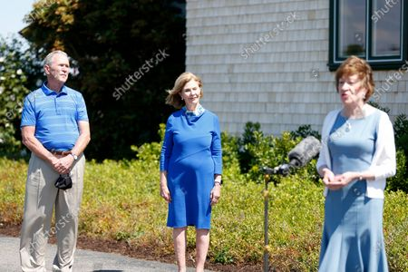 Stock Image of Sen. Susan Collins, R-Maine, right, speaks at a microphone after having lunch with former President George W. Bush and his wife Laura Bush, in Kennebunkport, Maine