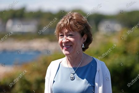 Stock Photo of Sen. Susan Collins, R-Maine smiles as she speaks to the media after having lunch with former President George W. Bush and his wife Laura Bush, in Kennebunkport, Maine