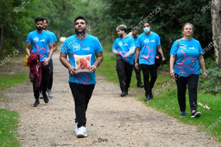 Shahid Khan, better known as DJ and producer Naughty Boy, takes part in a Memory Walk this afternoon with his family, joining thousands of people across the UK who are completing their own walk this summer, to raise vital funds for Alzheimer's Society. Naughty Boy's personal connection to dementia comes after his mother, Zahida was diagnosed with vascular dementia last year after having a stroke.