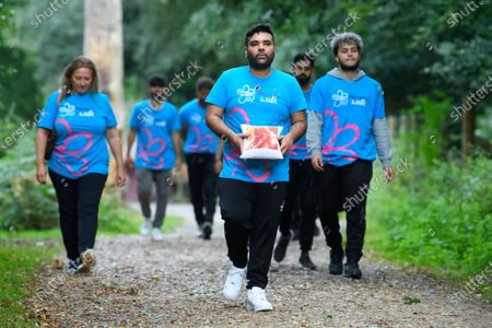 Stock Photo of Shahid Khan, better known as DJ and producer Naughty Boy, takes part in a Memory Walk this afternoon with his family, joining thousands of people across the UK who are completing their own walk this summer, to raise vital funds for Alzheimer's Society. Naughty Boy's personal connection to dementia comes after his mother, Zahida was diagnosed with vascular dementia last year after having a stroke.