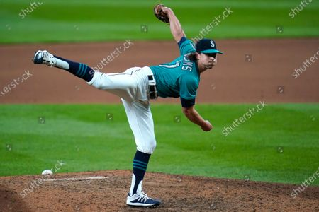 Seattle Mariners closing pitcher Taylor Williams follows-through on a pitch against the Texas Rangers in the ninth inning of a baseball game, in Seattle. The Mariners won 7-4