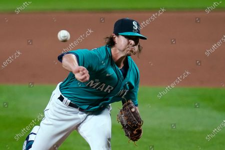 Seattle Mariners closing pitcher Taylor Williams throws against the Texas Rangers in the ninth inning of a baseball game, in Seattle. The Mariners won 7-4