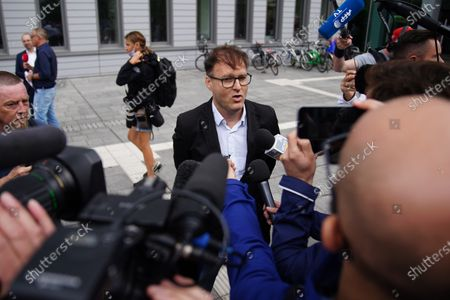 Stock Photo of Slovenian producer Jaka Bizilj speaks to media on the case of Russian opposition activist Alexei Navalny (not pictured) in front of Charite clinic in Berlin, Germany, 22 August 2020. Navalny was first placed in an hospital in Omsk, Russia, after he felt bad on board of a plane on his way from Tomsk to Moscow. The flight was interrupted and after landing in Omsk Navalny was delivered to hospital with a suspicion on a toxic poisoning. The hospital management agreed on 21 August 2020 to transport Navalny to a German hospital for further treatment.