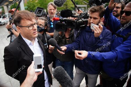 Slovenian producer Jaka Bizilj (L) speaks to media on the case of Russian opposition activist Alexei Navalny (not pictured) in front of Charite clinic in Berlin, Germany, 22 August 2020. Navalny was first placed in an hospital in Omsk, Russia, after he felt bad on board of a plane on his way from Tomsk to Moscow. The flight was interrupted and after landing in Omsk Navalny was delivered to hospital with a suspicion on a toxic poisoning. The hospital management agreed on 21 August 2020 to transport Navalny to a German hospital for further treatment.