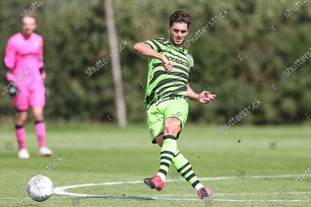 Forest Green Rovers Jordan Moore-Taylor(15) passes the ball forward during the Pre-Season Friendly match between Forest Green Rovers and Bristol Rovers at Stanley Park, Chippenham