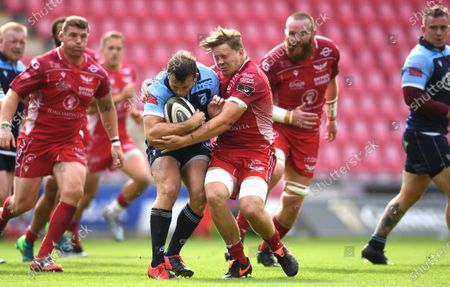 Garyn Smith of Cardiff Blues is tackled by James Davies of Scarlets.