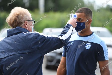 Ben Thomas of Cardiff Blues has his temperature taken as he arrives.