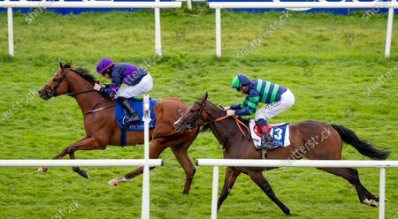 Stock Picture of Mark Enright on Rough Diamond holds off Kevin Manning on Na Blianta Ben to win The Mick O`Shea Heating And Plumbing Maiden