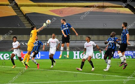 Yassine Bounou of Sevilla saves from Diego Godin of Inter Milan during the UEFA Europa League Final between Seville and FC Internazionale at RheinEnergieStadion on August 21, 2020 in Cologne, Germany.